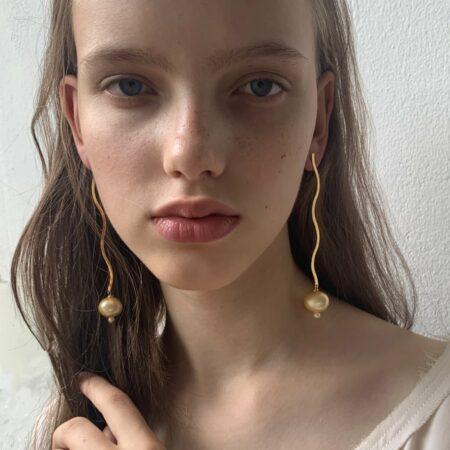 Ariel Metal Baby Yellow Sphere Pearl Long Earrings